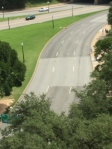 The road is marked with  X's showing where the president was hit.