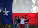 Us and our friends standing before the Lone Star flag of the great State of Texas 7.4.2014