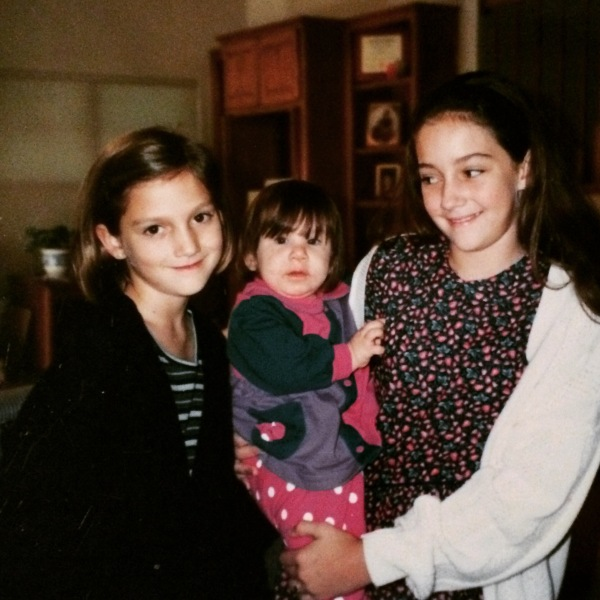Our daughter Olivia, held by her two cousins, 11.10.1996