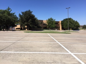 The parking lot sits empty as CEC's former  home awaits a new tenant. 9.14.2015